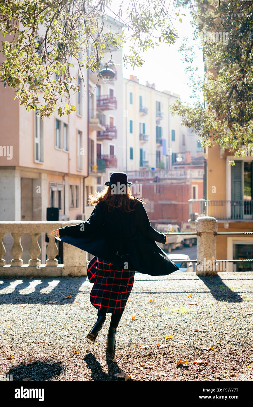 Italy, Verona, vital young woman in the city - Stock Image