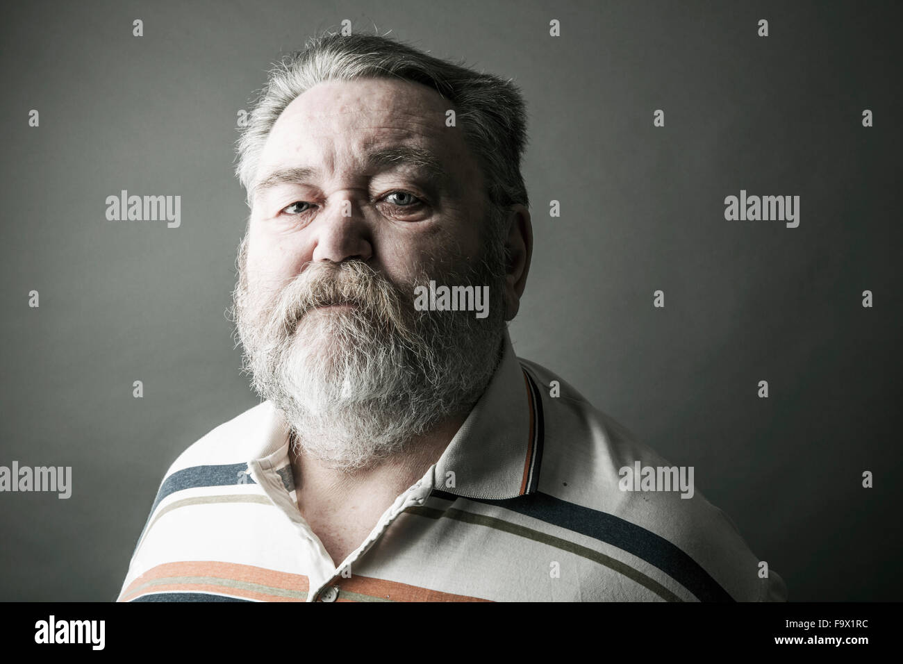 Portrait of senior man with full beard Stock Photo