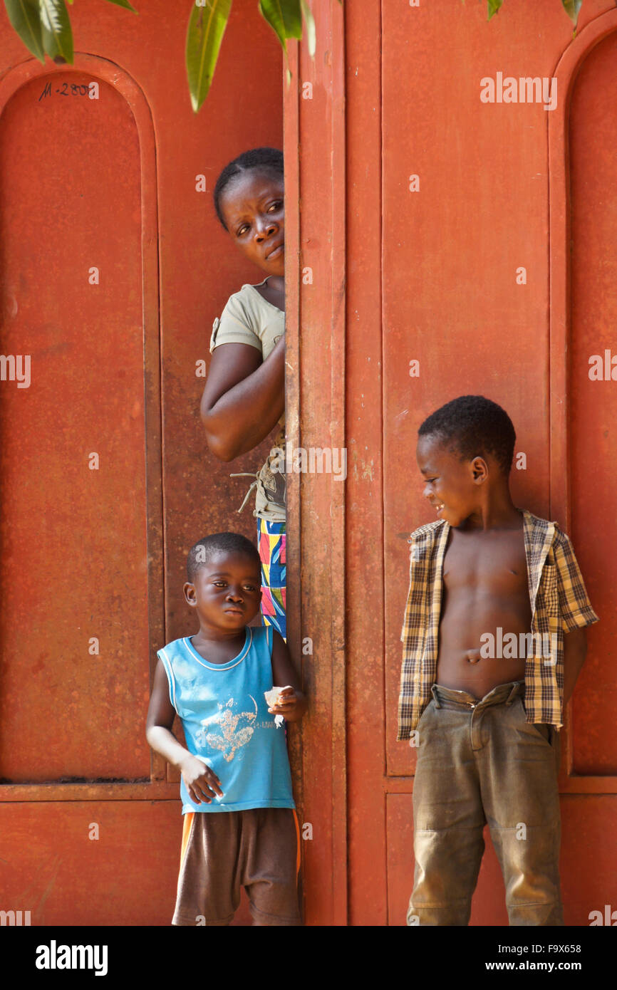 Woman and children in front their home, Lome, Togo - Stock Image