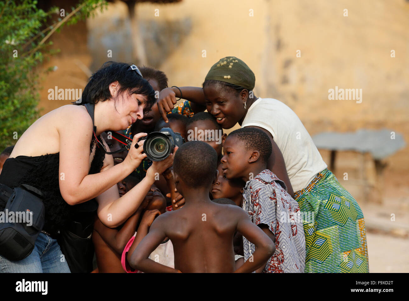 Tourism in an African village. - Stock Image