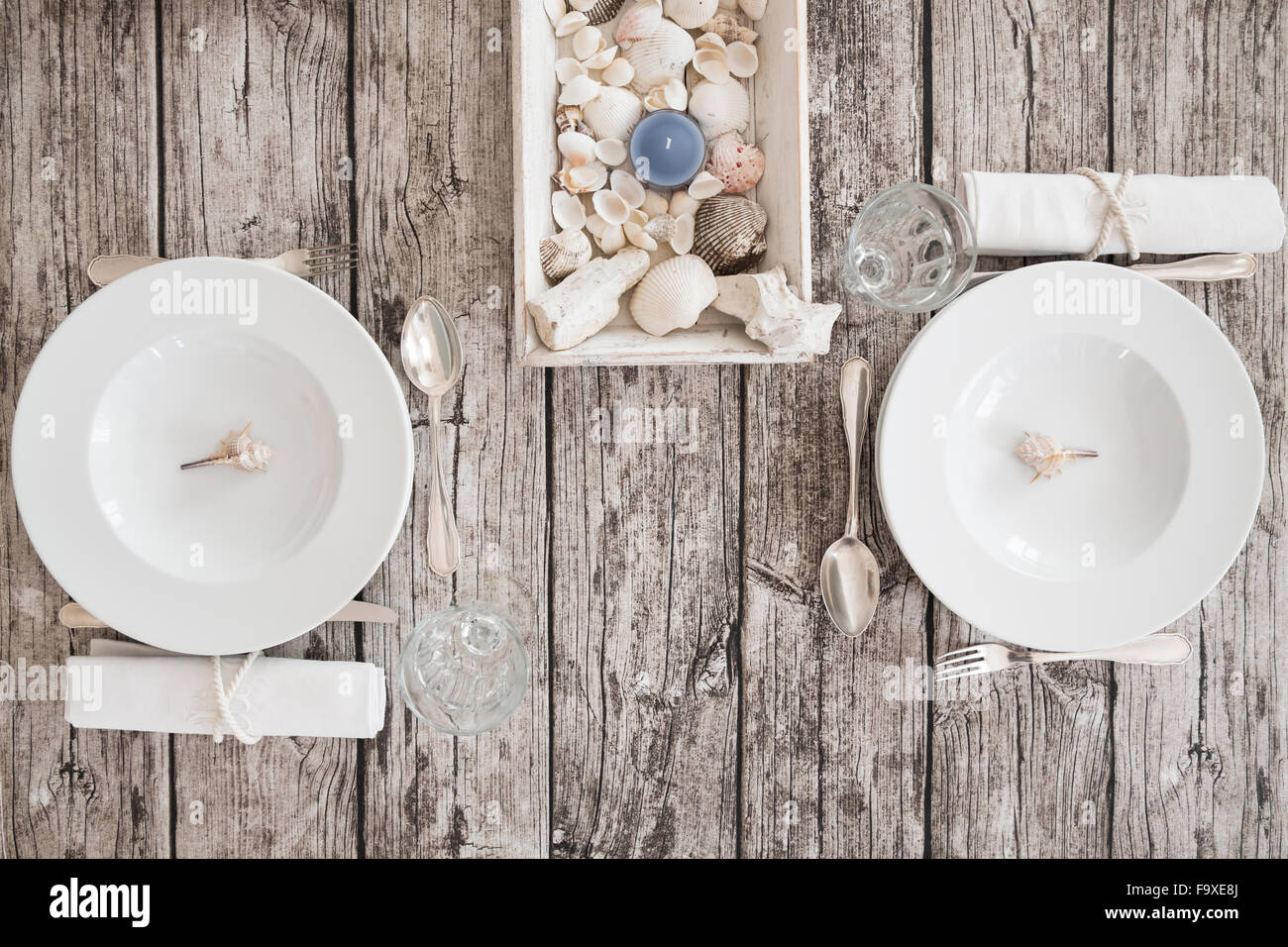 Two place settings on maritime laid table - Stock Image