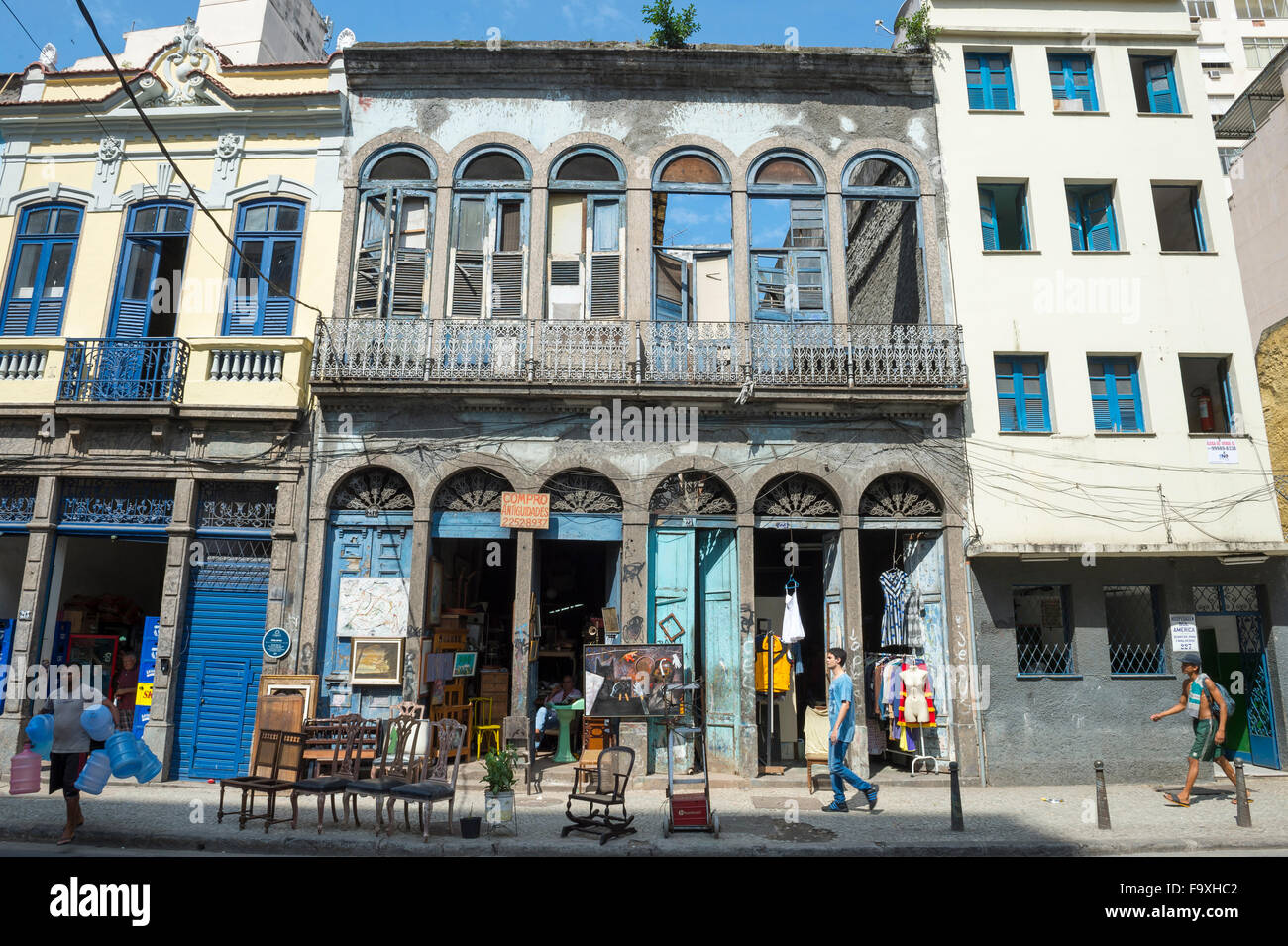 RIO DE JANEIRO, BRAZIL - OCTOBER 22, 2015: Pedestrians pass in front of eclectic architecture in the Santa Teresa Stock Photo