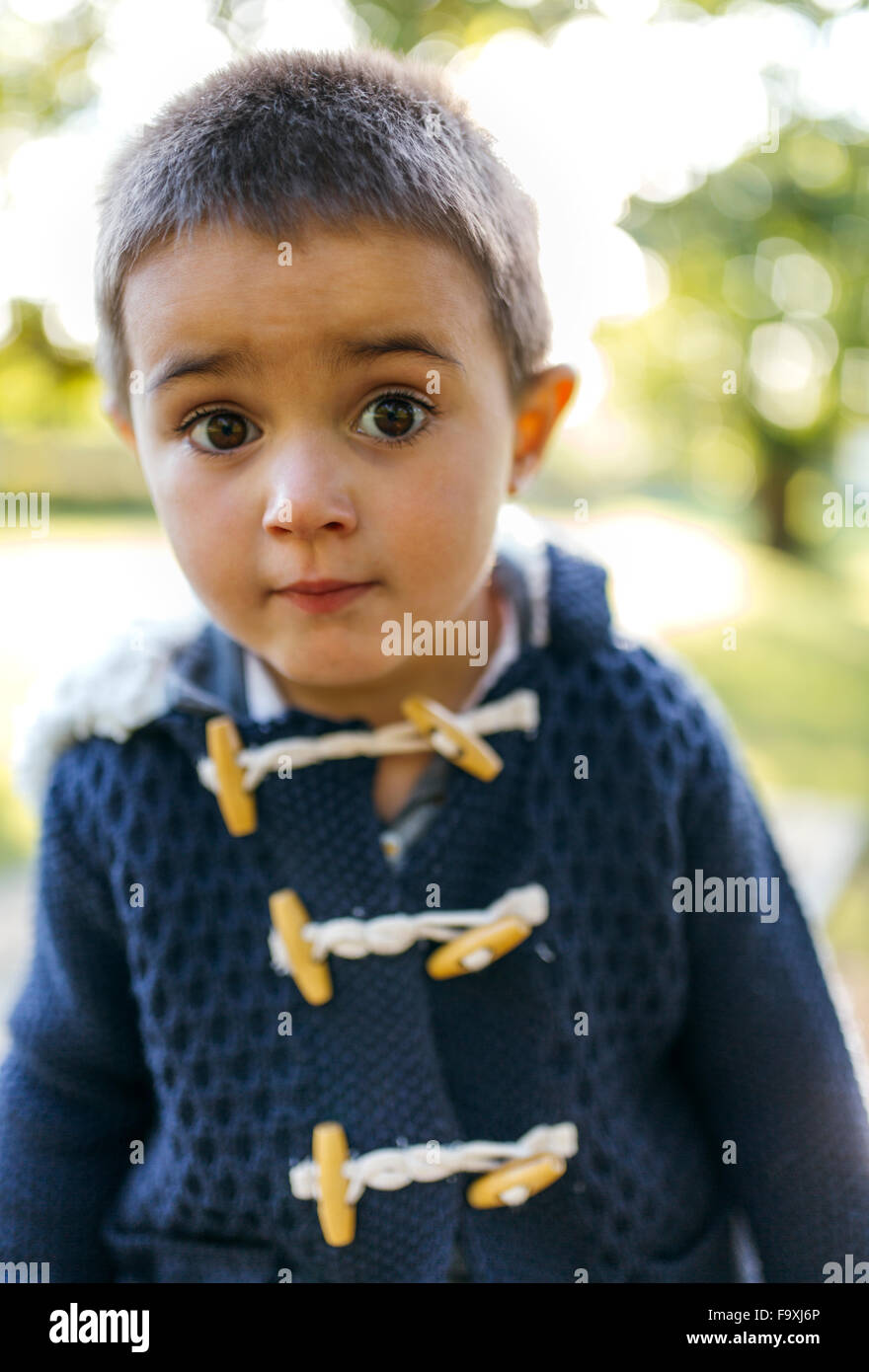 Portrait of little boy with eyes wide open Stock Photo
