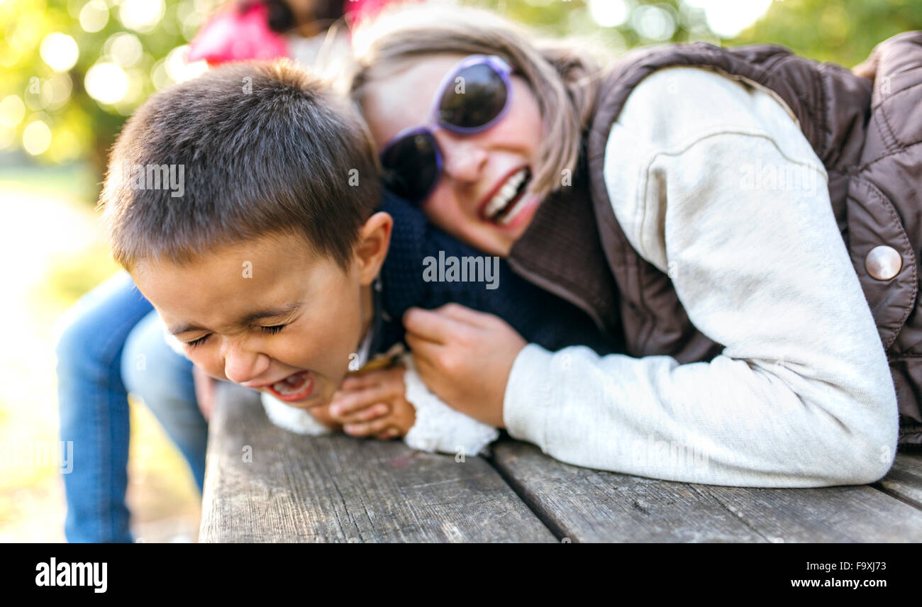 Children playing together in a park Stock Photo