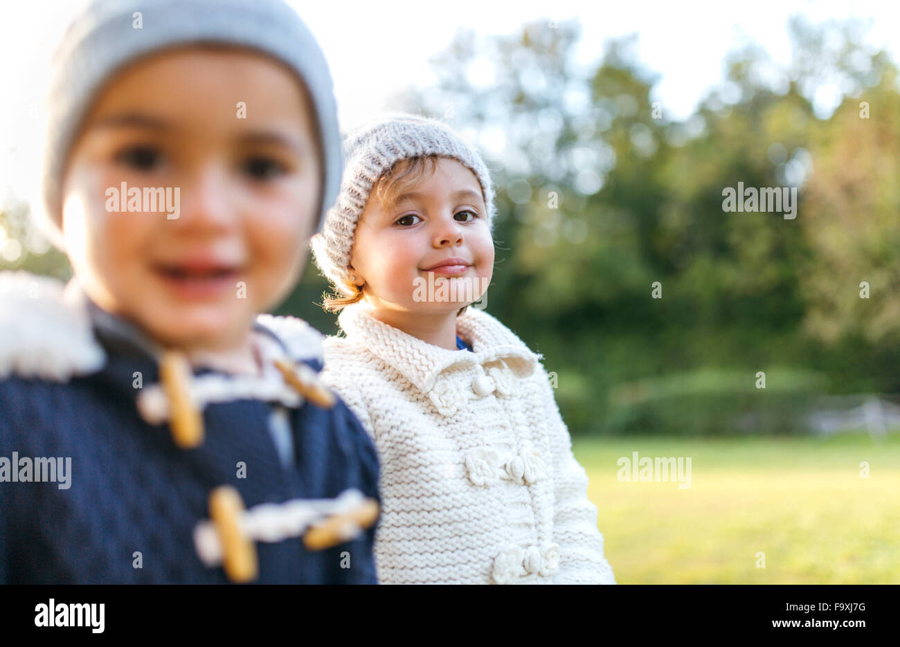 Happy little kids in a park - Stock Image