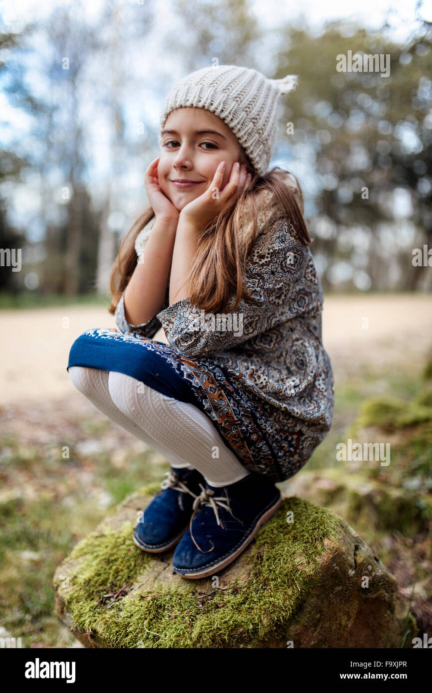 Attractive Young Woman Crouching Stock Photo - Image of