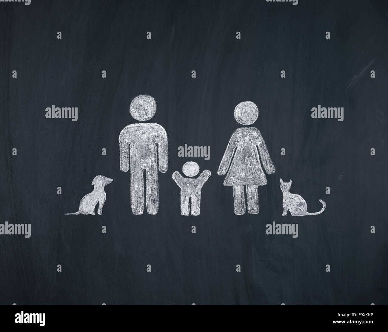 Chalk drawing of family with child and pets - Stock Image