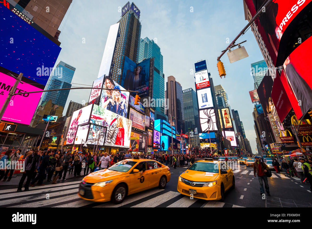NEW YORK CITY, USA - DECEMBER 13, 2015: Bright signage flashes over holiday crowds and traffic in Times Square before - Stock Image
