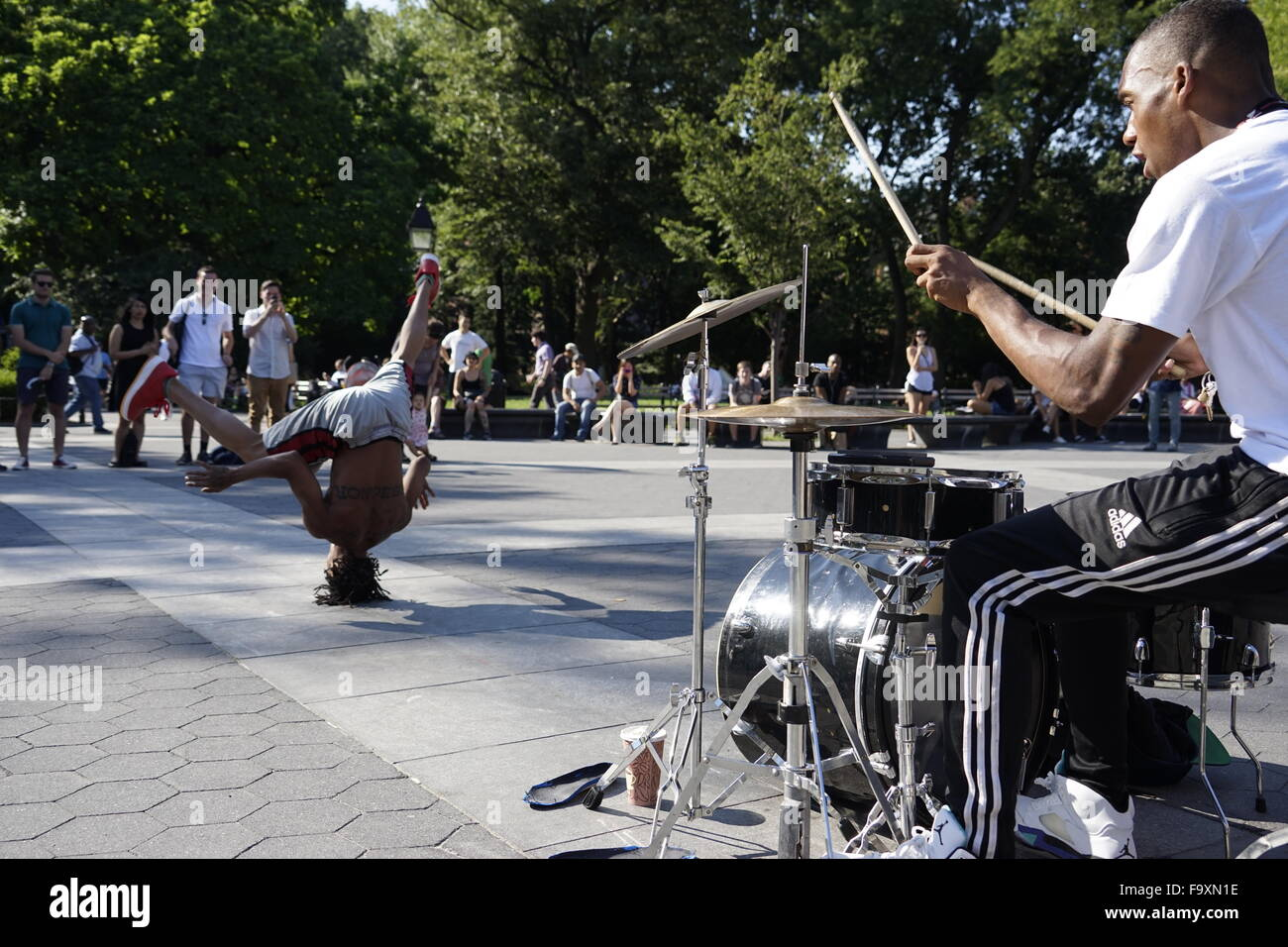 Street performer break dancing at Washington Square Park, Greenwich Village, New York City, USA Stock Photo