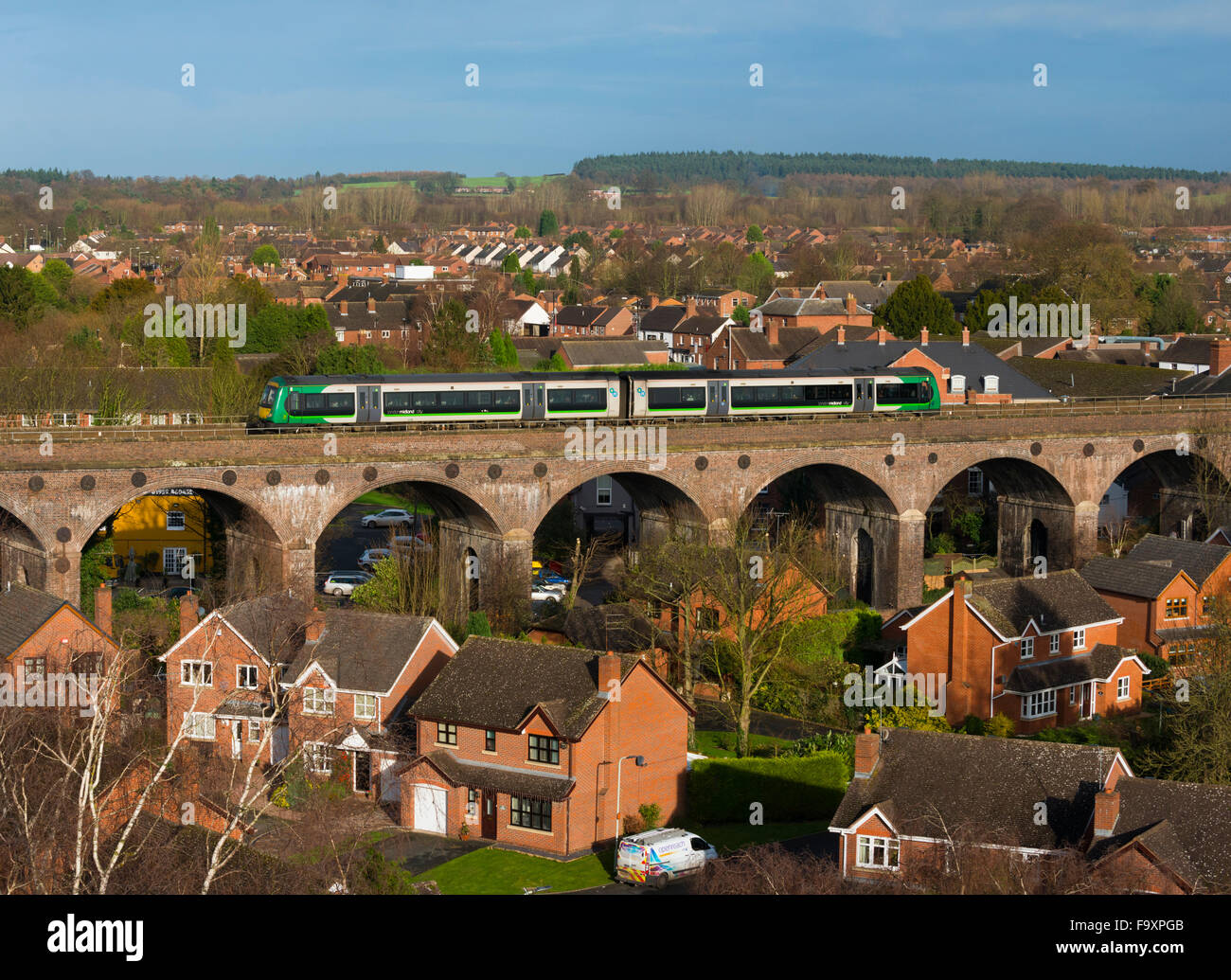 A London Midland train on the viaduct passing through Shifnal, Shropshire, England. - Stock Image