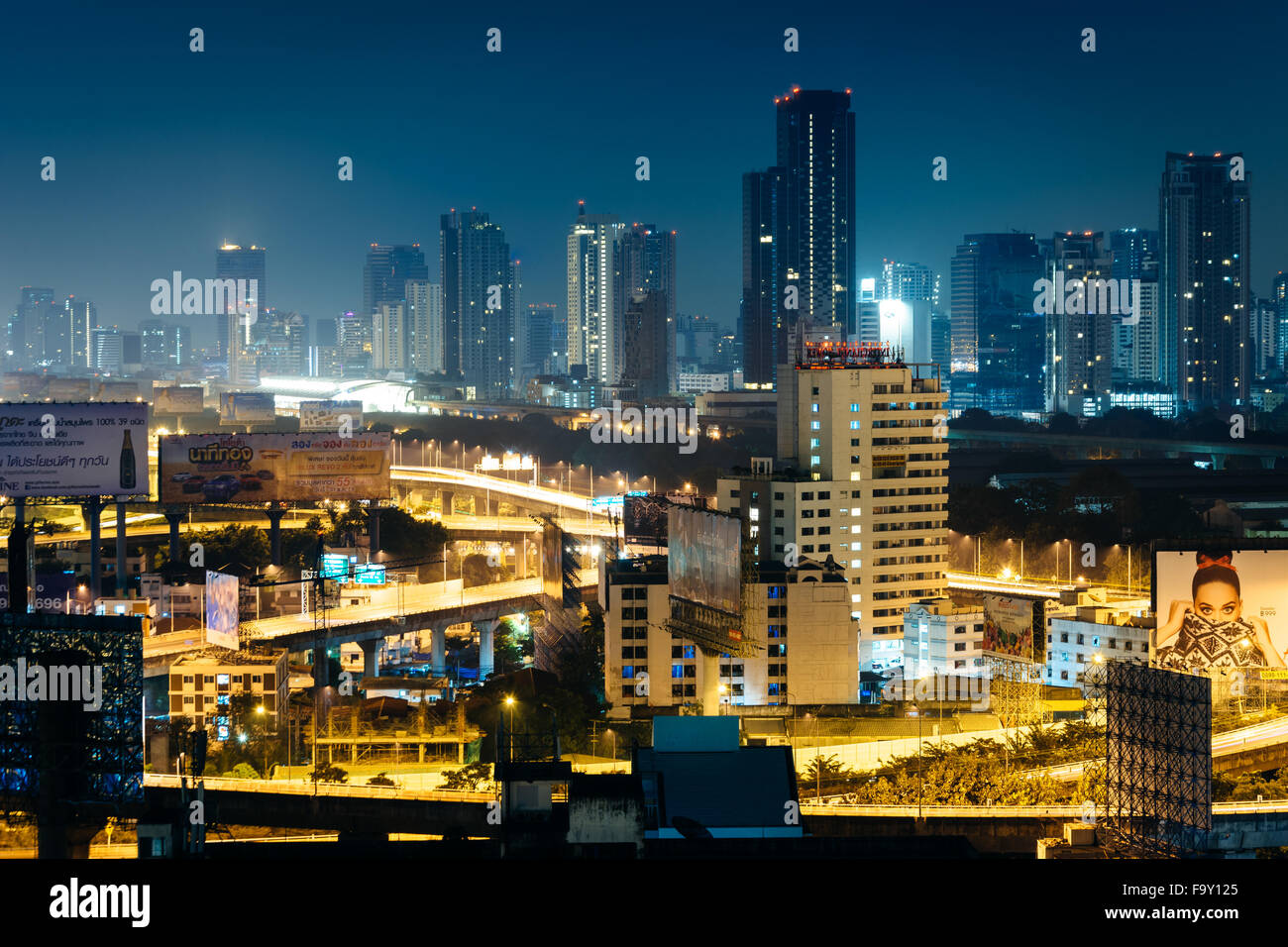 View of skyscrapers at night, in Bangkok, Thailand. - Stock Image