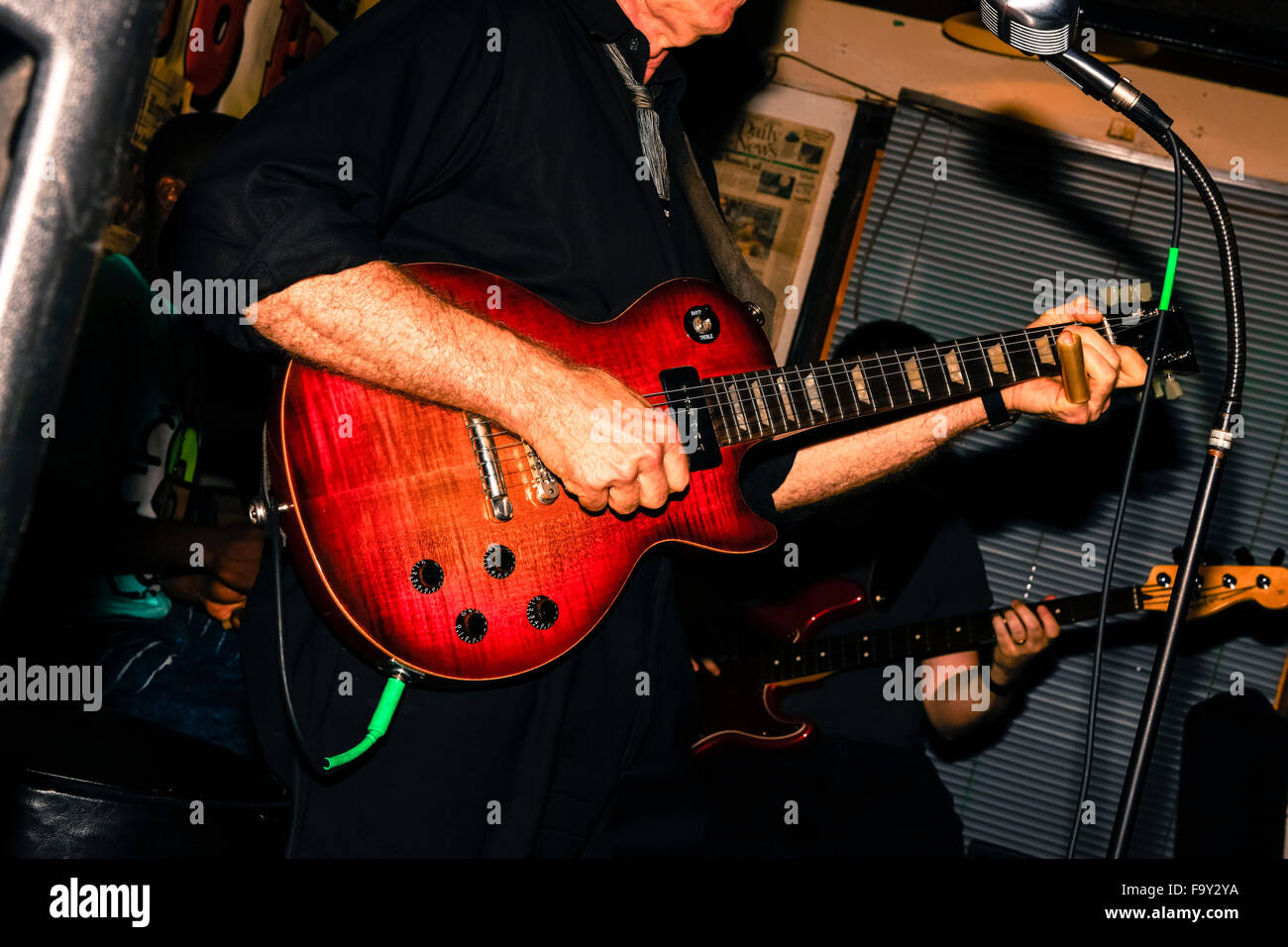 Close up of guitarist Preston Rumbaugh playing in a Mississippi Juke joint in Clarksdale, birthplace of Blues music - Stock Image