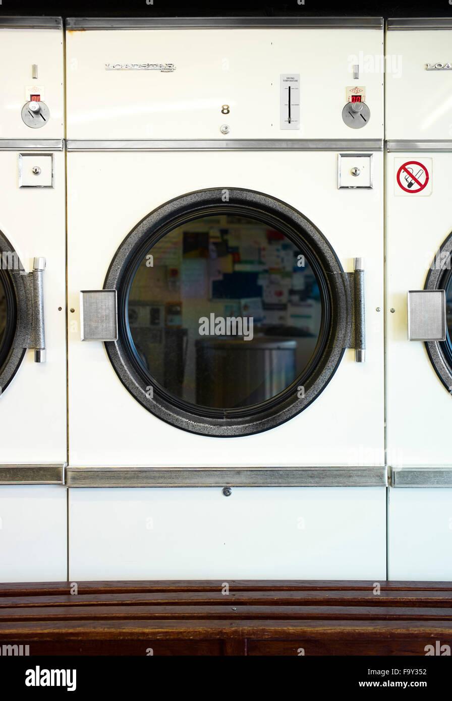 Loadstar drying machine in laundrette - Stock Image