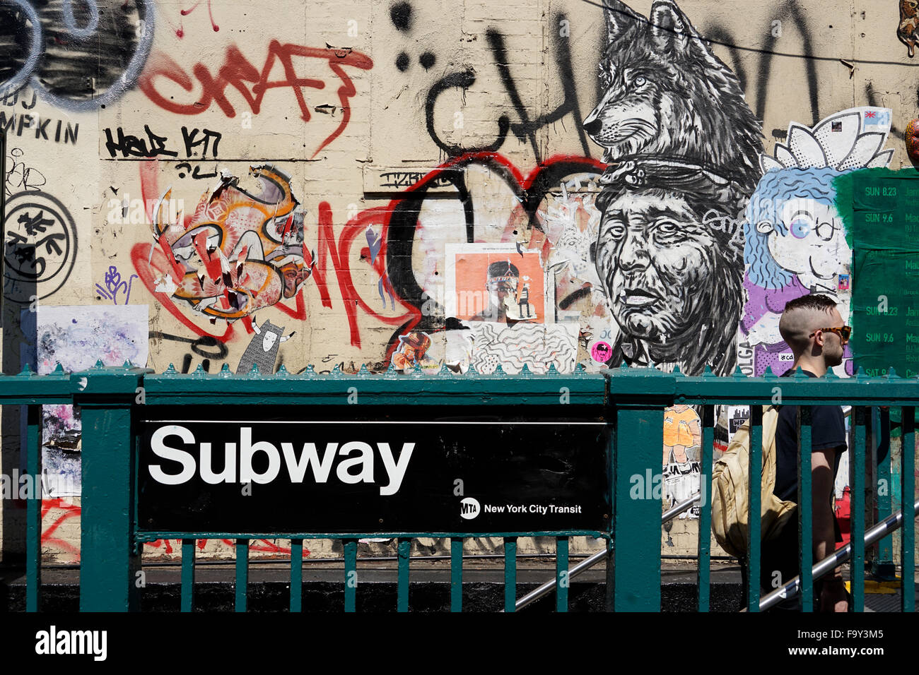 New York City Subway Station With Graffiti In The Background And Subway Rider Walking Up The Stairs Usa