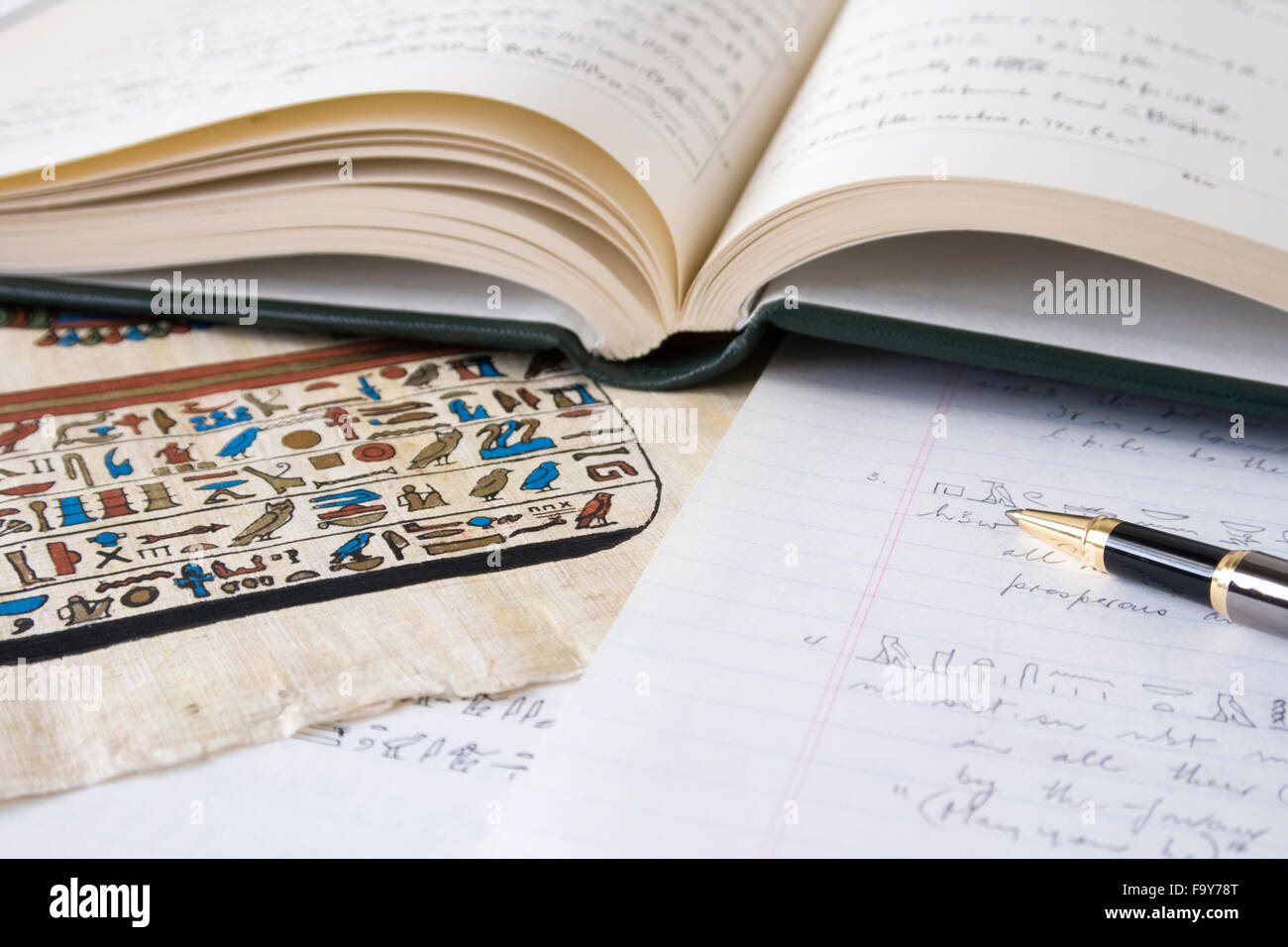 Book of Egyptian Hieroglyphs with pen and translation - Stock Image