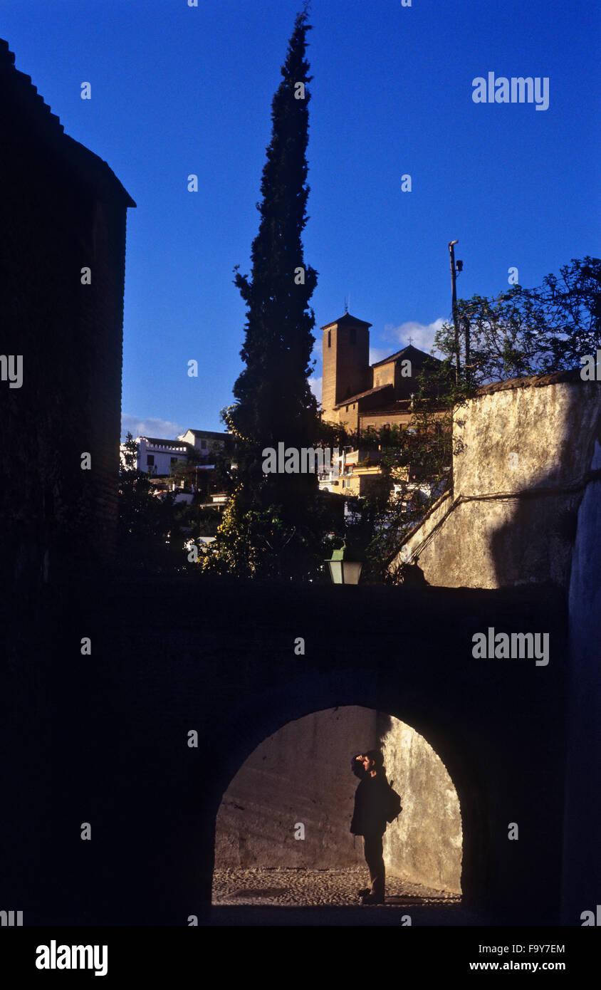 Callejón de las Monjas, in Background San Cristobal church. Albaicín quarter. Granada, Andalucia, Spain - Stock Image
