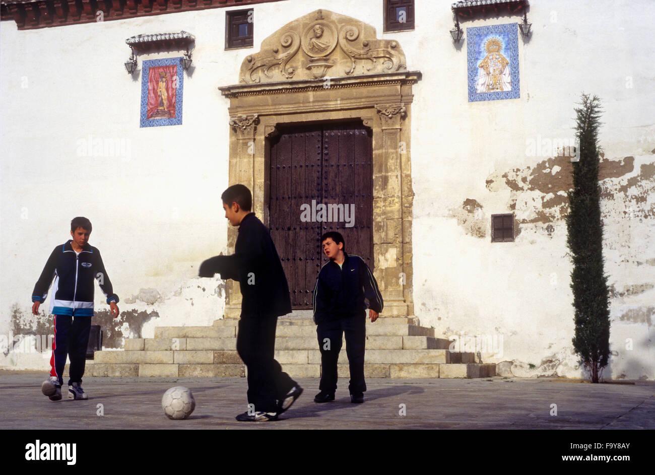 Playing football. In Plaza San Miguel Bajo.Albaicín quarter. Granada, Andalucia, Spain - Stock Image