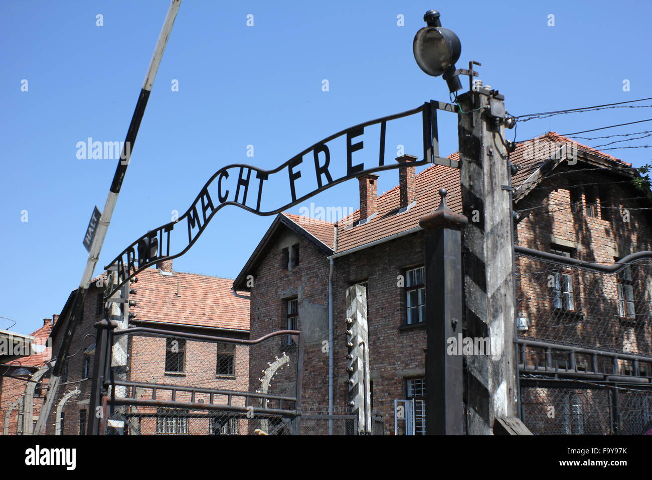Arbeit Macht Frei sign at the main gate of Auschwitz concentration camp Poland - Stock Image