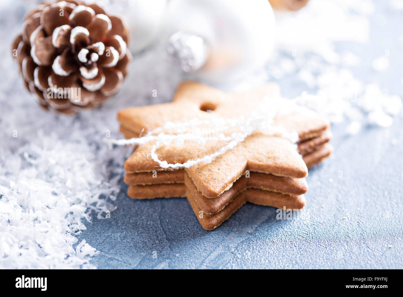 Christmas ornaments and gingerbread cookies with snow - Stock Image