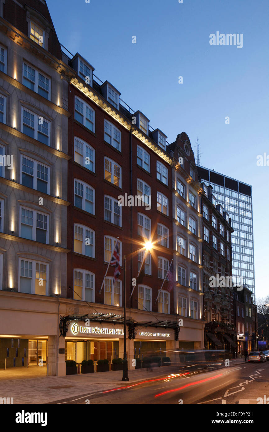 The hotel exterior at dusk from an oblique angl, the Intercontinental hotel in Westminster. - Stock Image