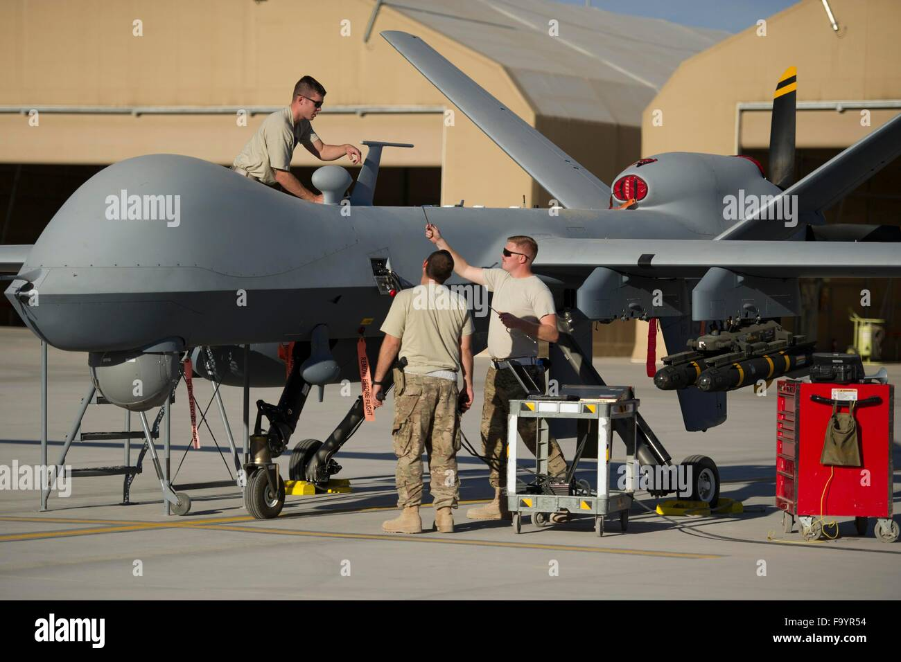 U.S. Air Force airmen with the 62nd Expeditionary Reconnaissance Squadron maintain the new extended range MQ-9 Reaper - Stock Image