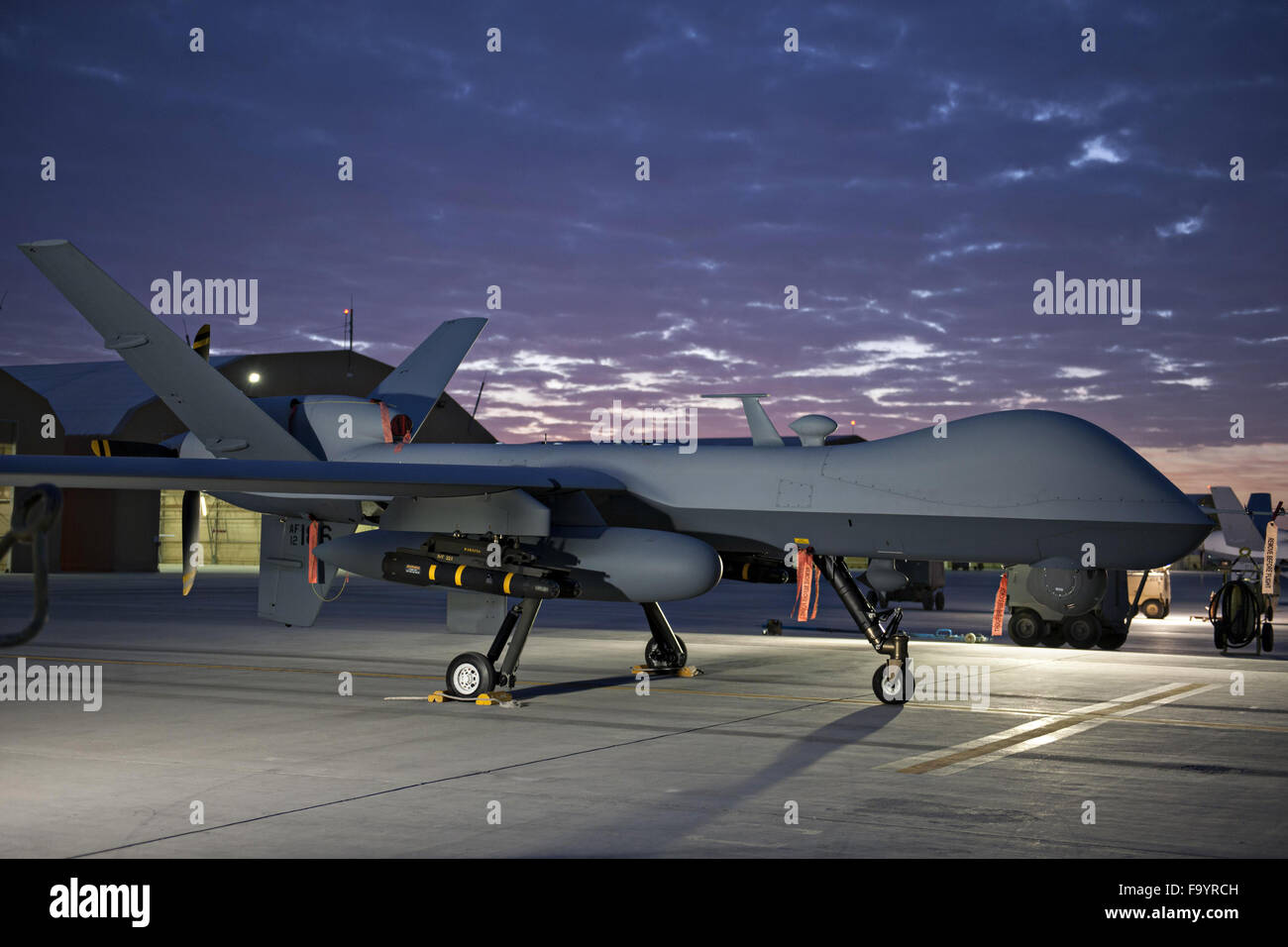 A U.S. Air Force extended range MQ-9 Reaper drone with the 62nd Expeditionary Reconnaissance Squadron on the ramp - Stock Image