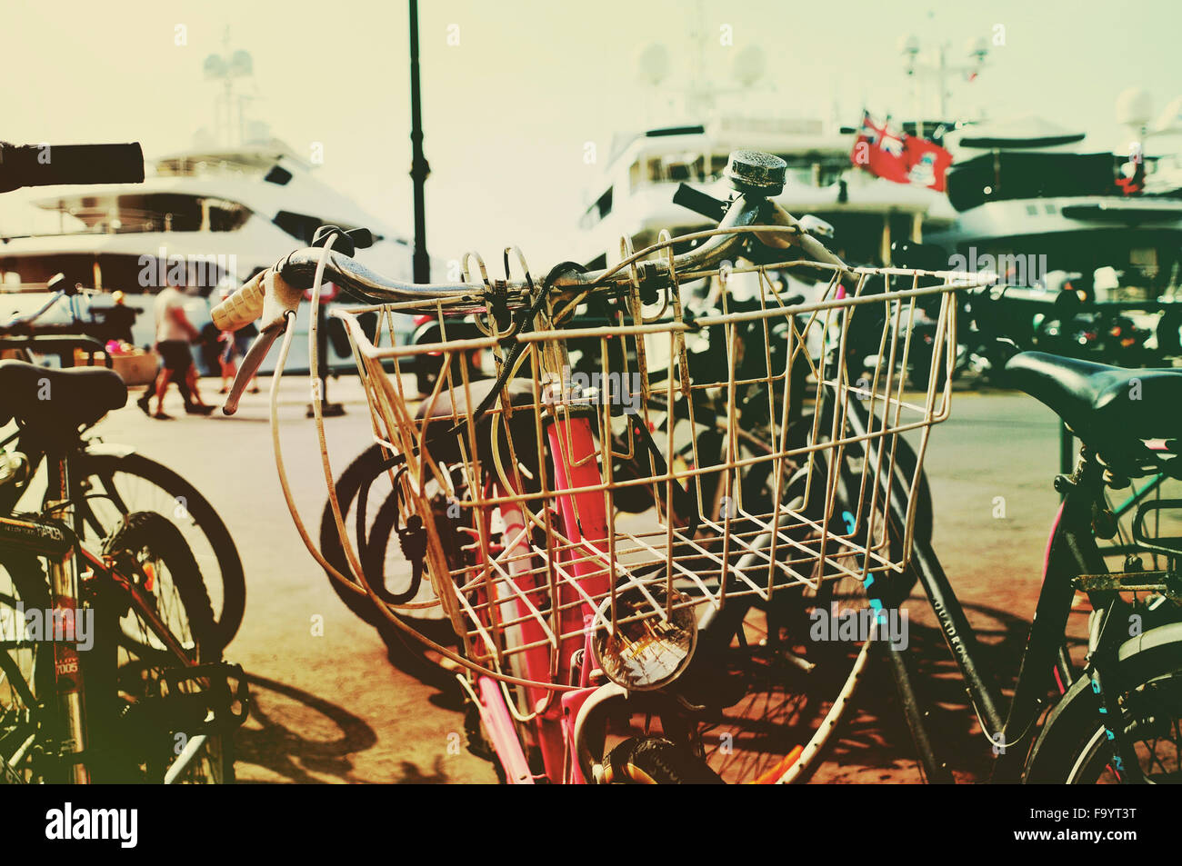 closeup of some bicycles parked in the port of Saint-Tropez, France, with a filtered effect - Stock Image