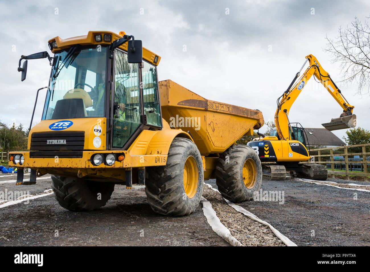 Yellow Heavy Dumper Truck And Jcb Digger Excavator Plant Machinery