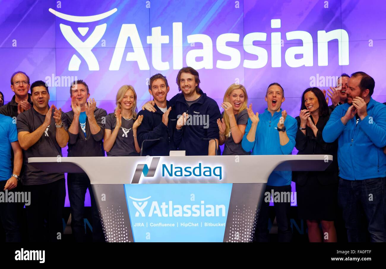 Atlassian co-founders Scott Farquhar (left) and Mike Cannon-Brookes with their families - Stock Image