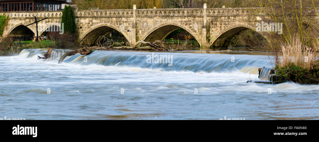 High water flow over Weir near Bath on the River Avon, carrying trees with it. BATH, SOMERSET, UK - 16 DEC 2015 Stock Photo