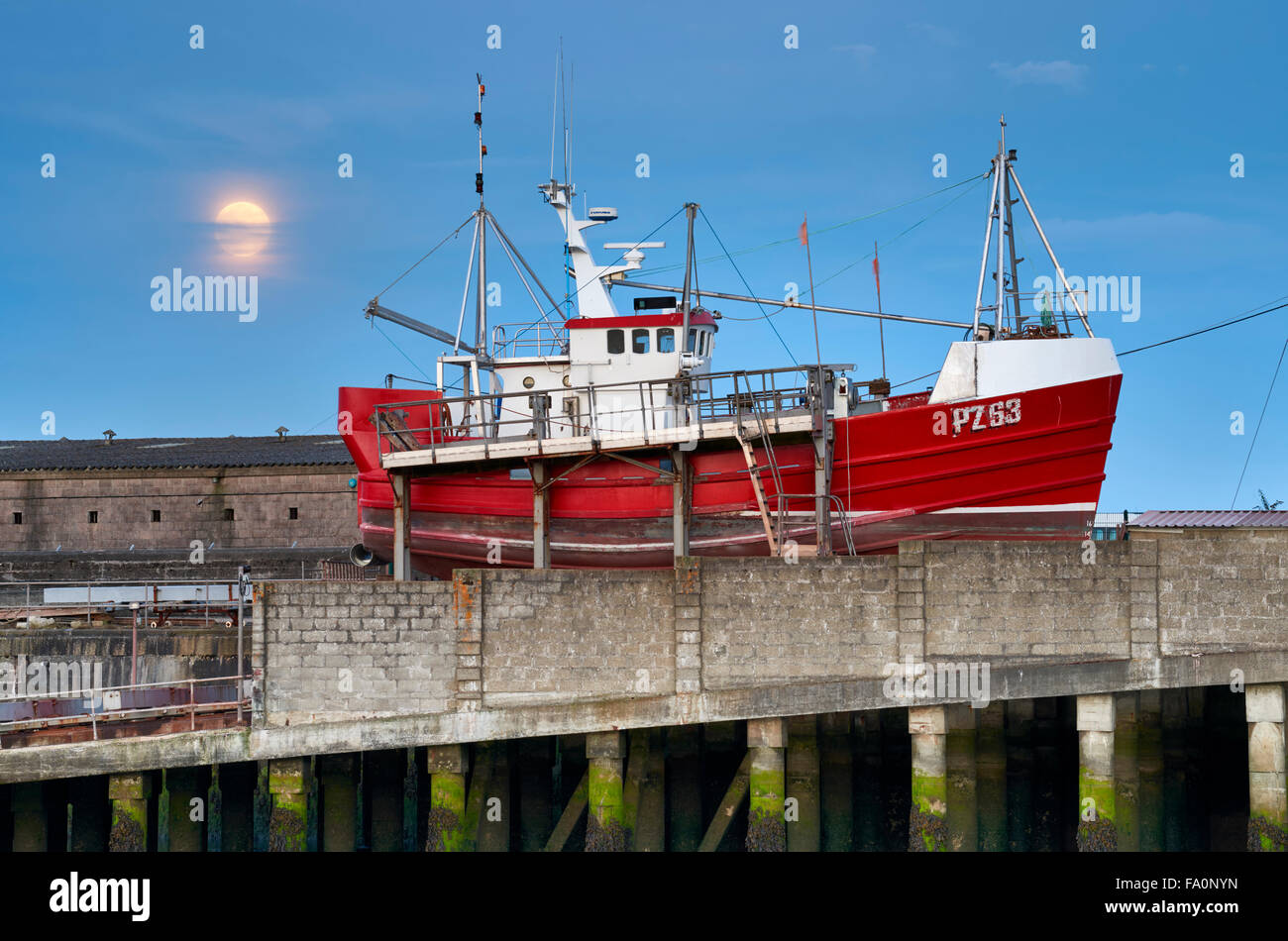 Fishing boat having routine maintenance and a repaint, Newlyn - Stock Image