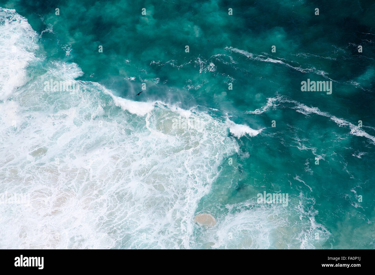 An aerial view of the pattern formed by the waves breaking against the coast at Cape Point in South Africa - Stock Image