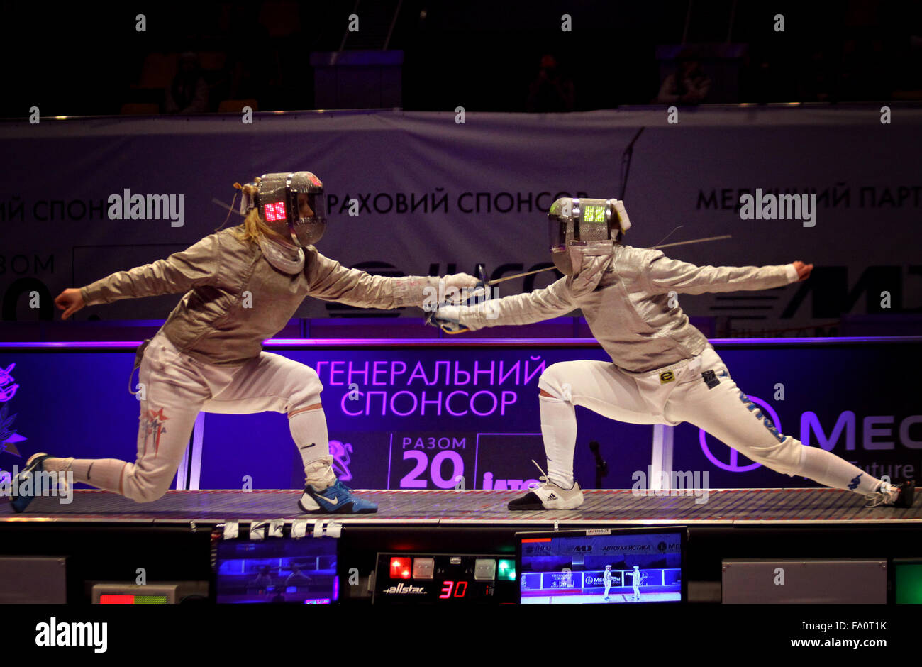 KYIV, UKRAINE - APRIL 13, 2012: Mariel Zagunis of USA (L) fights against Irene Vecchi of Italy during Womens Sabre Stock Photo