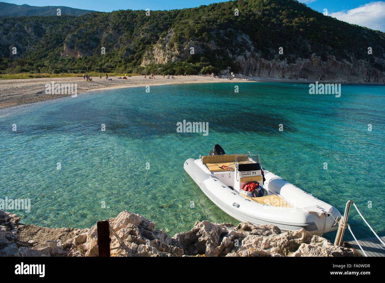 Cala Luna beach, Gulfo di Orosei, Sardinia Italy with boat in foreground - Stock Image