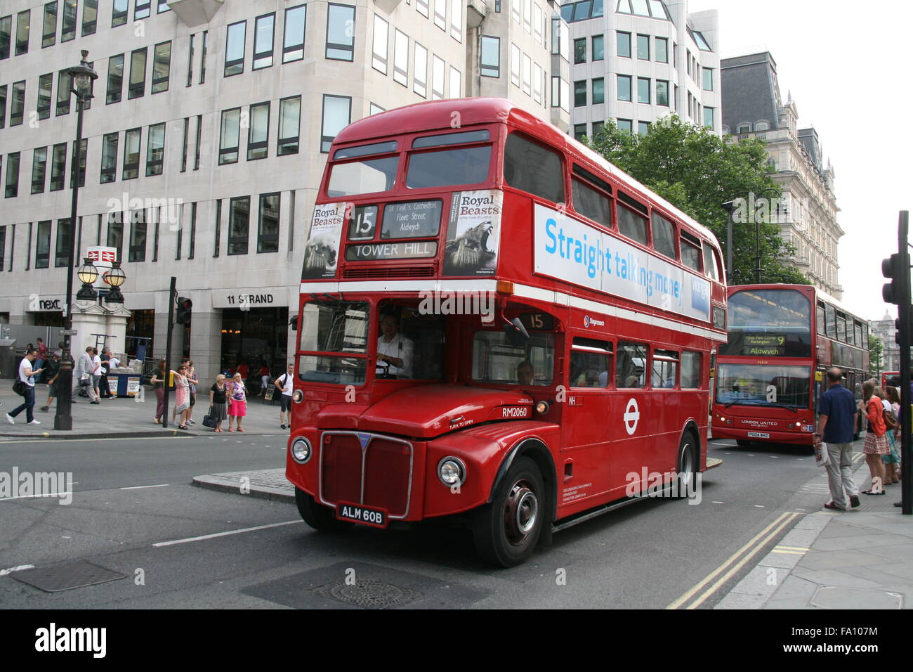 A FRONT NEARSIDE LANDSCAPE VIEW OF A RED TRADITIONAL LONDON ROUTEMASTER BUS OPERATED BY STAGECOACH ON ROUTE 15 - Stock Image
