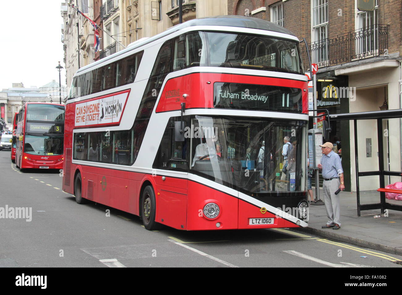A LONDON GENERAL RED AND WHITE NEW ROUTEMASTER BUS WORKING IN WHITEHALL LONDON ON SERVICE 11 OPERATED BY GO-AHEAD - Stock Image