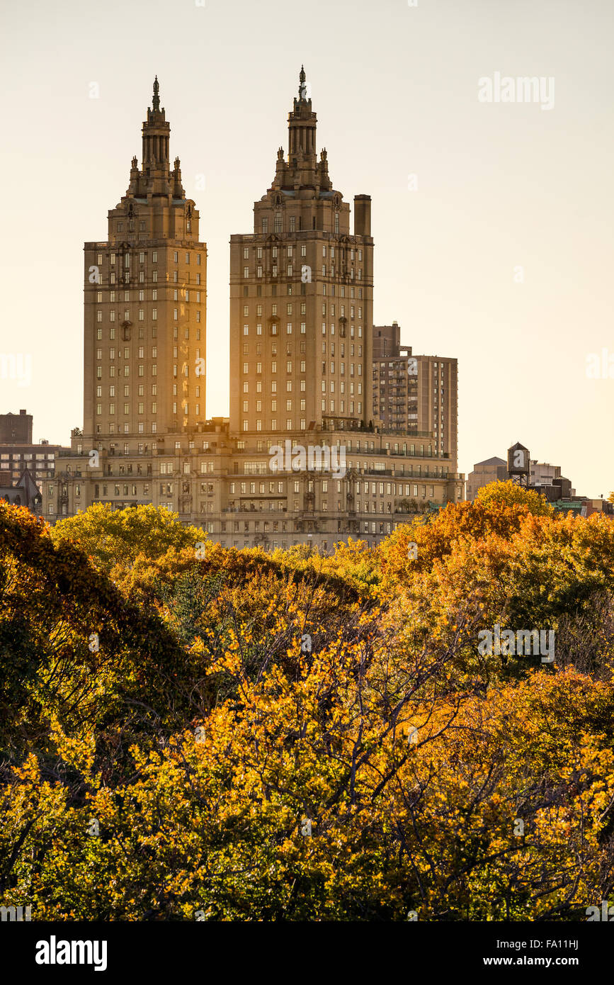 View of the San Remo Building at sunset with Central Park autumn foliage, Upper West Side, Manhattan, New York City - Stock Image