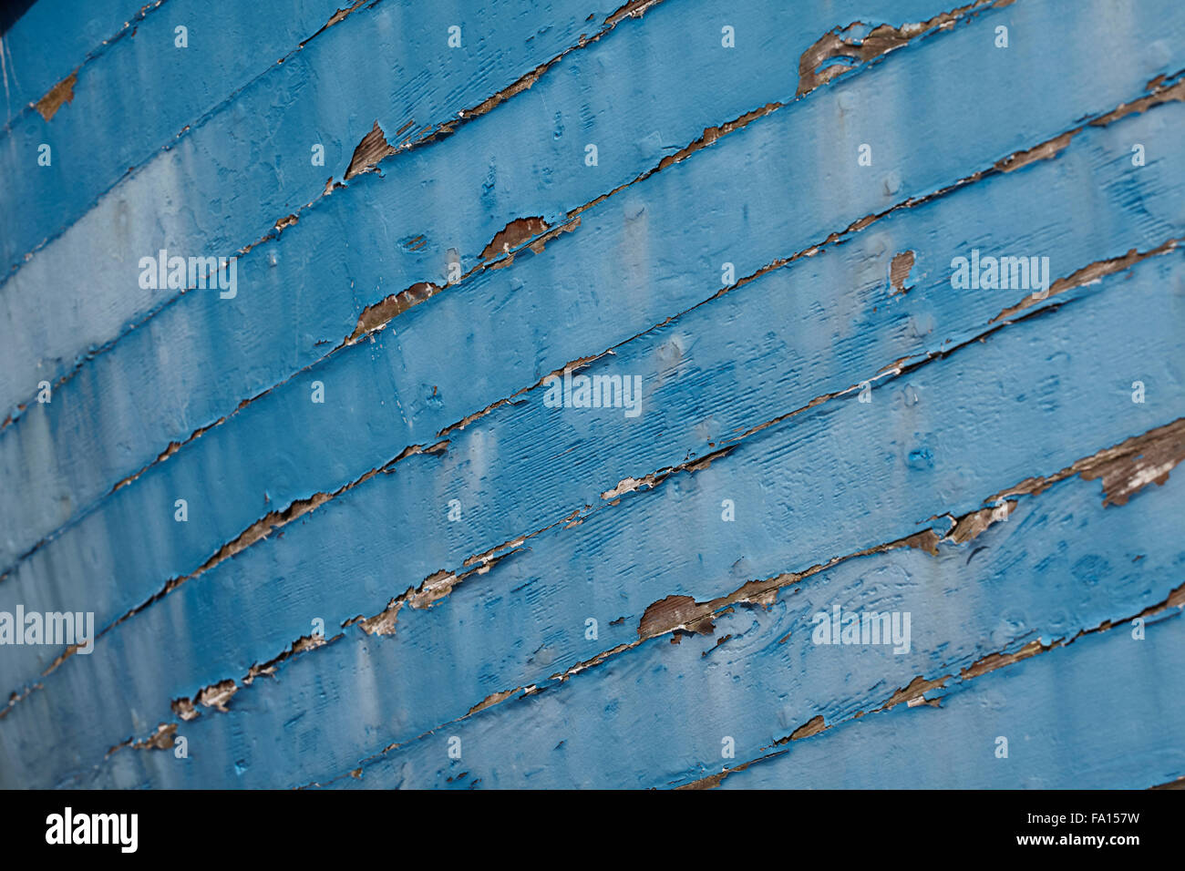 Peeling paint on an old boat - Stock Image