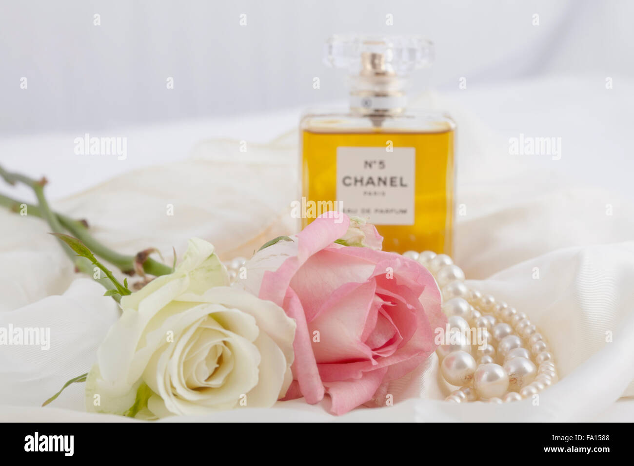 Roses with pearls and Chanel perfume - Stock Image