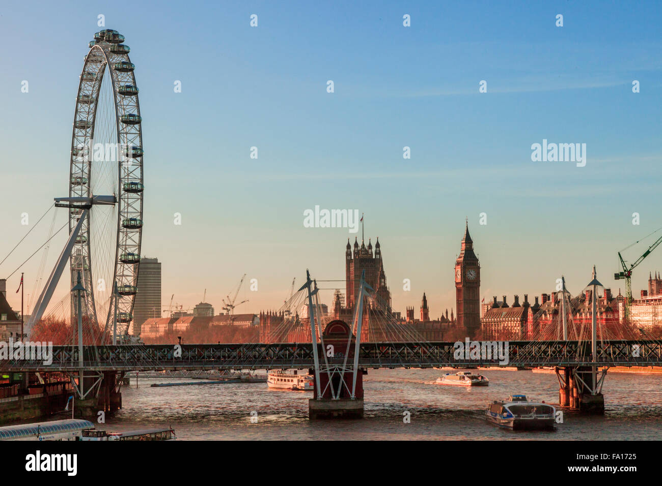 Looking along the River Thames towards the Houses of Parliament and the London Eye, London 2015 - Stock Image