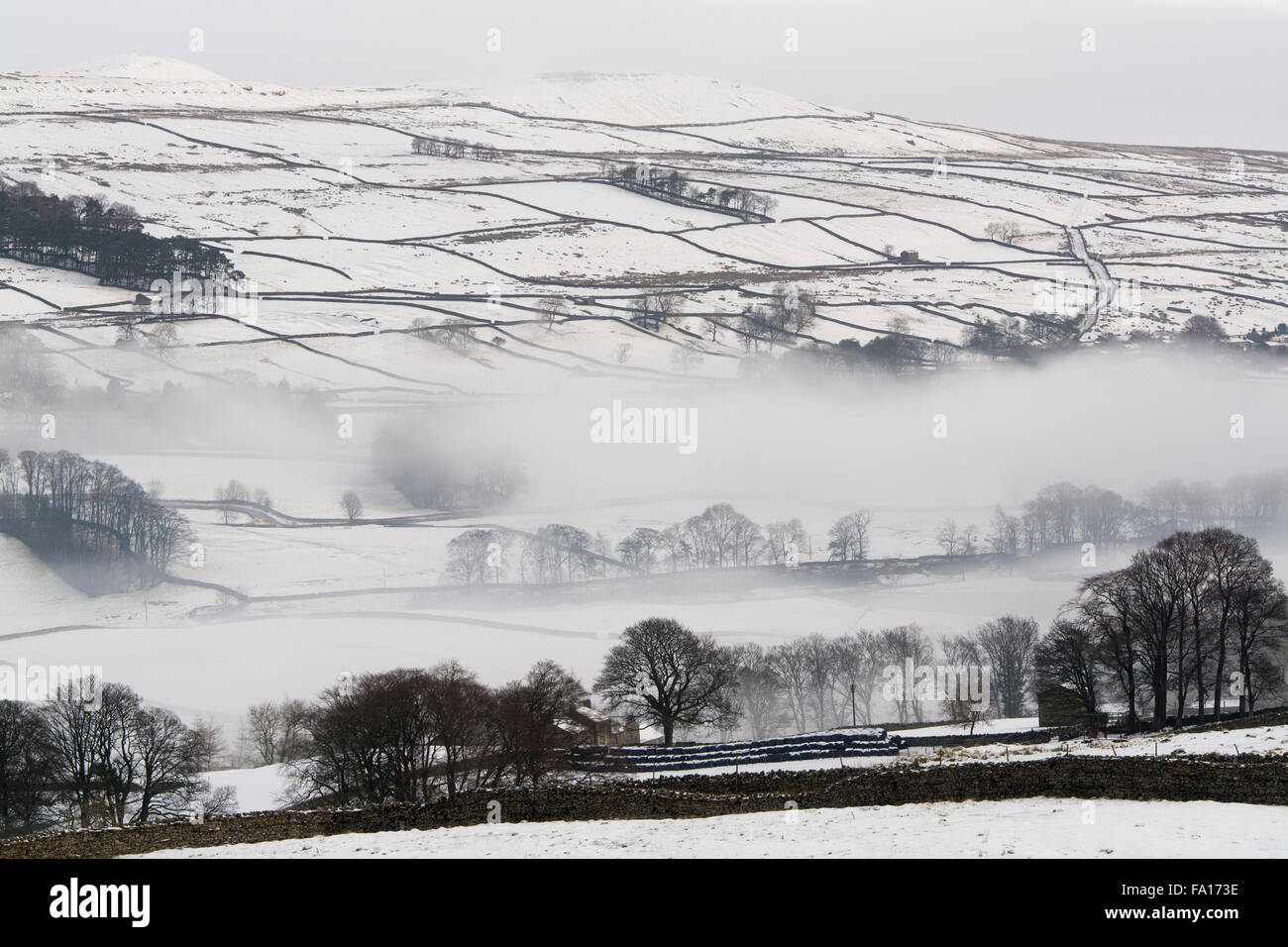 Misty snow covered landscape near Hawes in Wensleydale, North Yorkshire Stock Photo