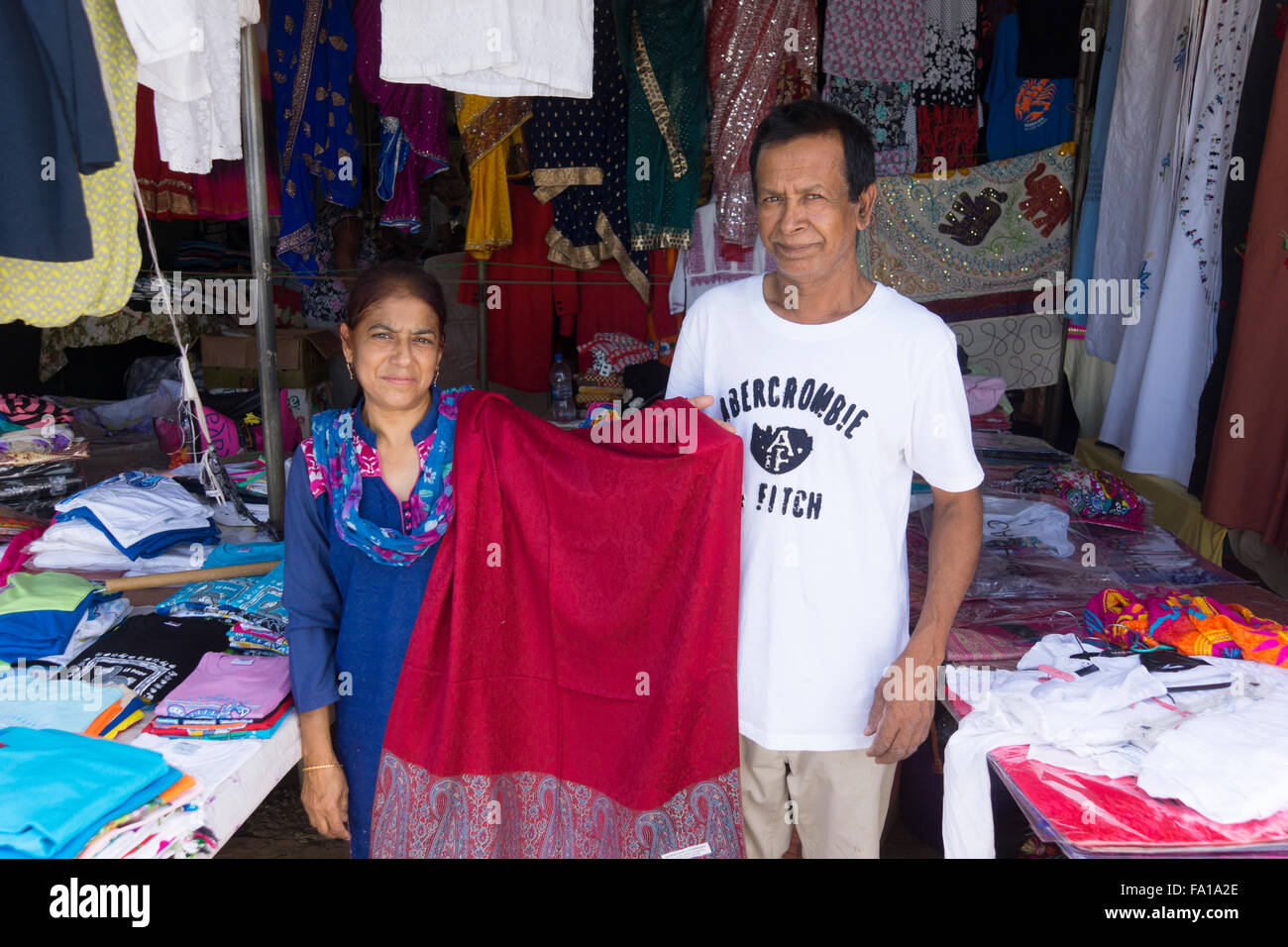 A local couple selling garments at the textile market at Goodlands in northern Mauritius - Stock Image