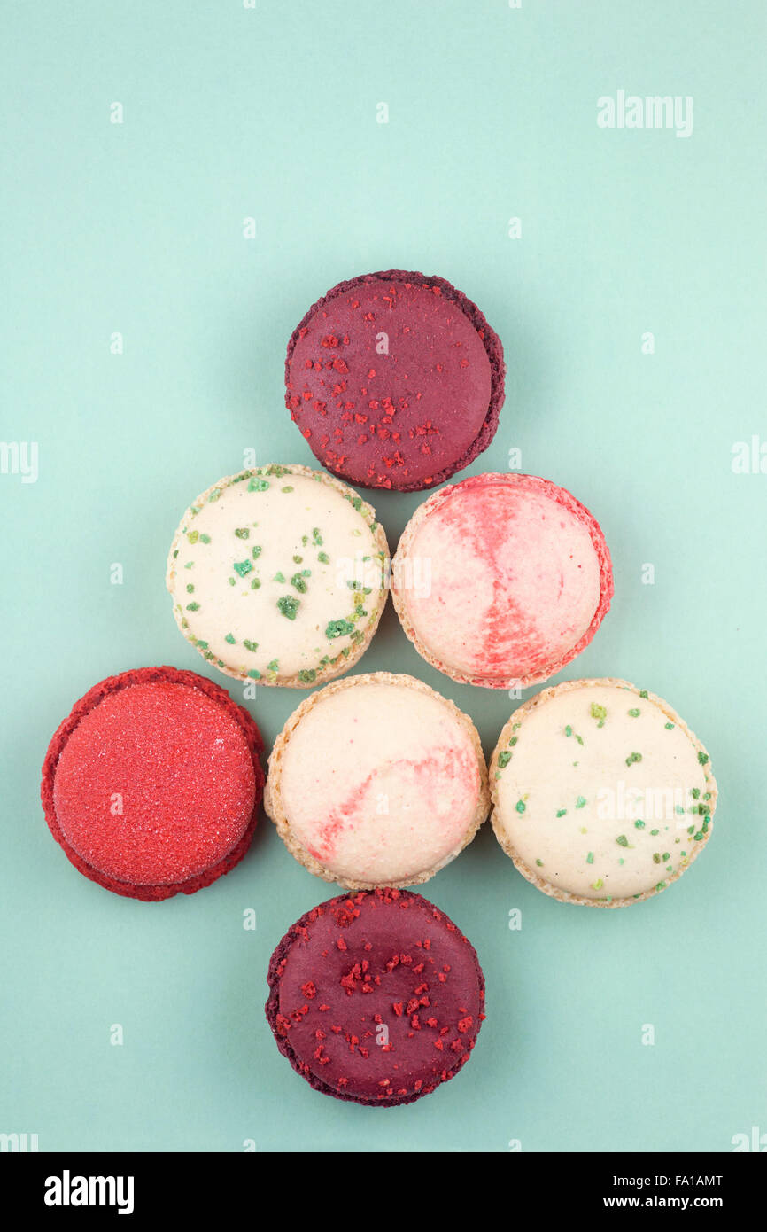 Christmas macarons in the shape of a tree: frosted cranberry, vanilla basil, mulled wine and candy cane flavours - Stock Image