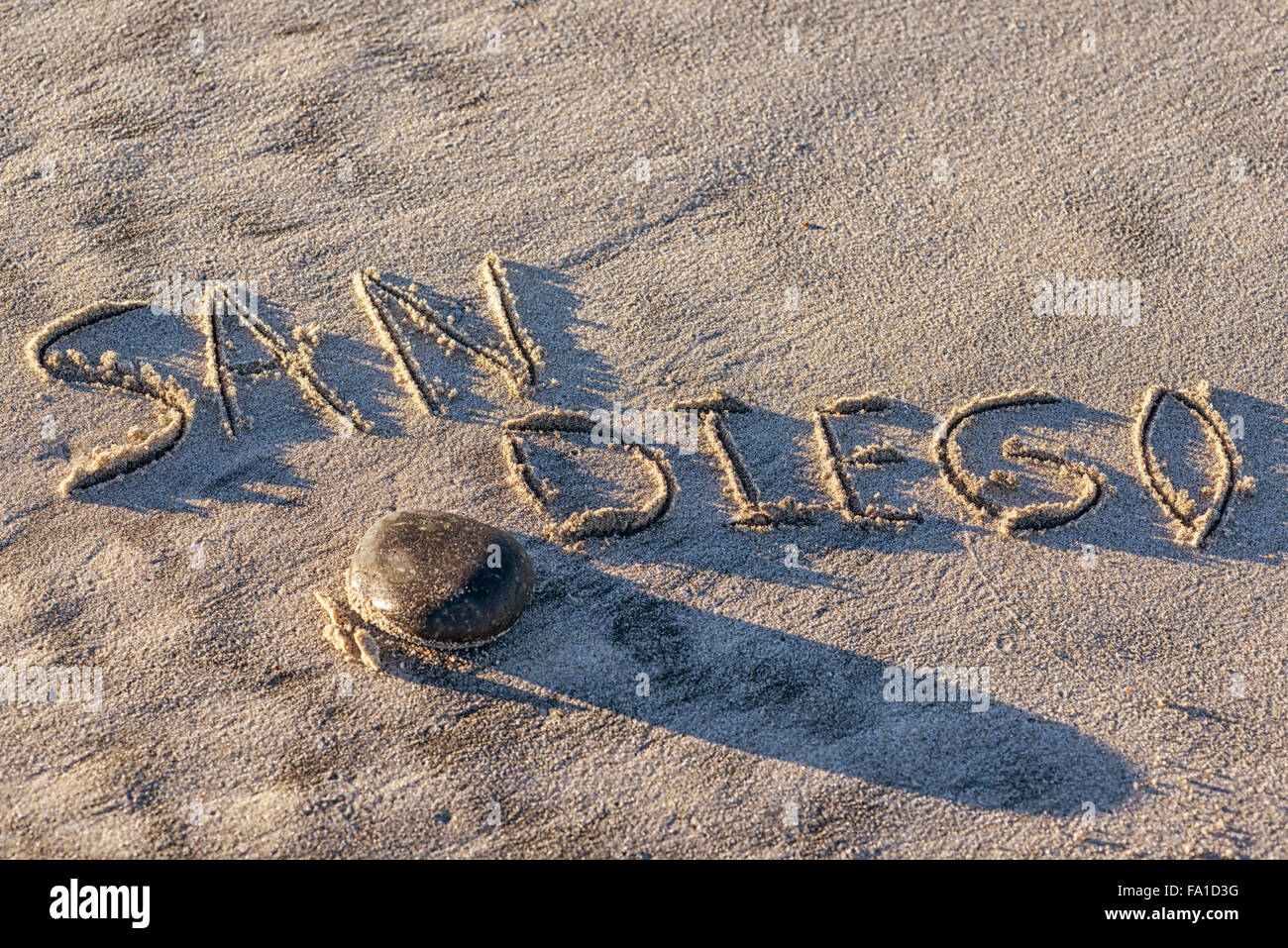 The word San Diego written in the sand. - Stock Image
