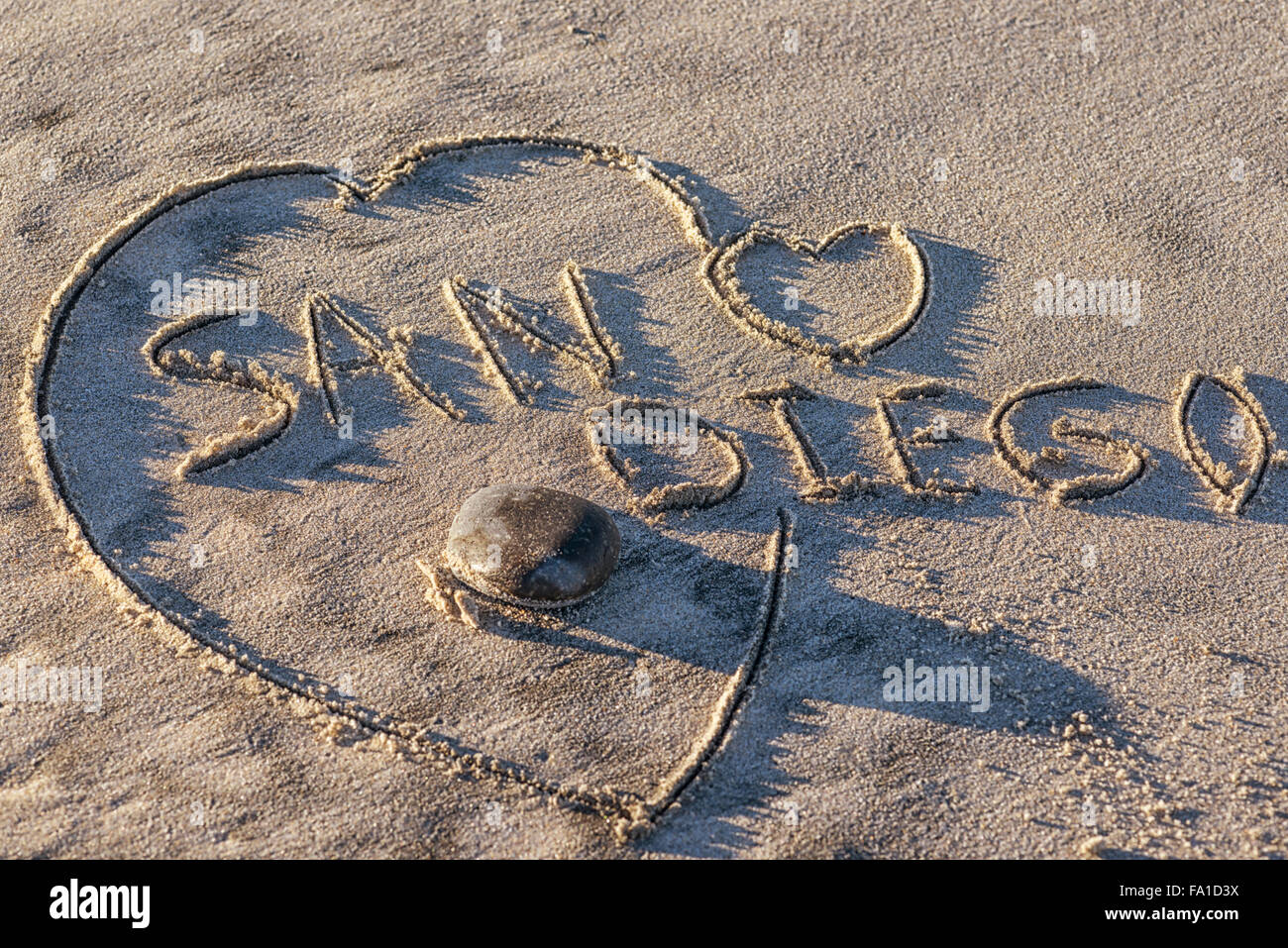 The word San Diego written in the sand. heart shape, beach. - Stock Image