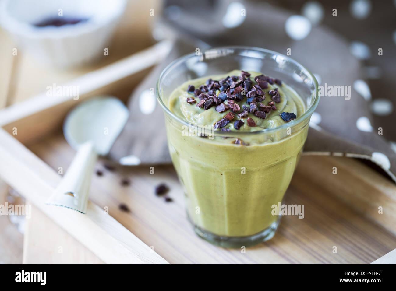 Homemade Avocado smoothie with Cacao nibs - Stock Image