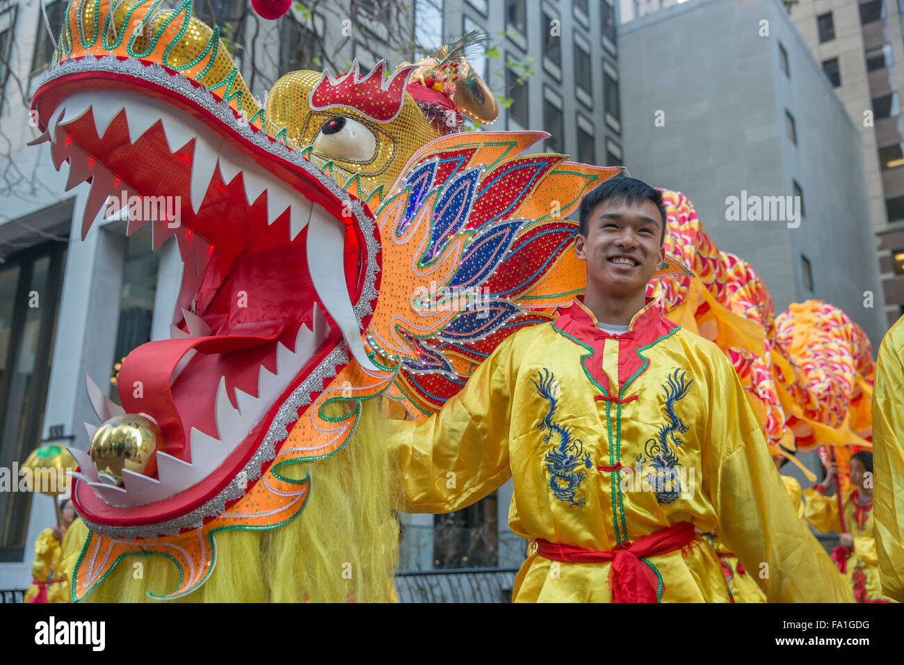 Dragon handler dressed in costume at San Francisco Chinese New Year parade. - Stock Image
