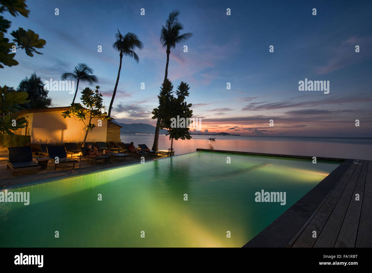 Sunset over an infinity edge pool on Koh Samui island, Thailand - Stock Image