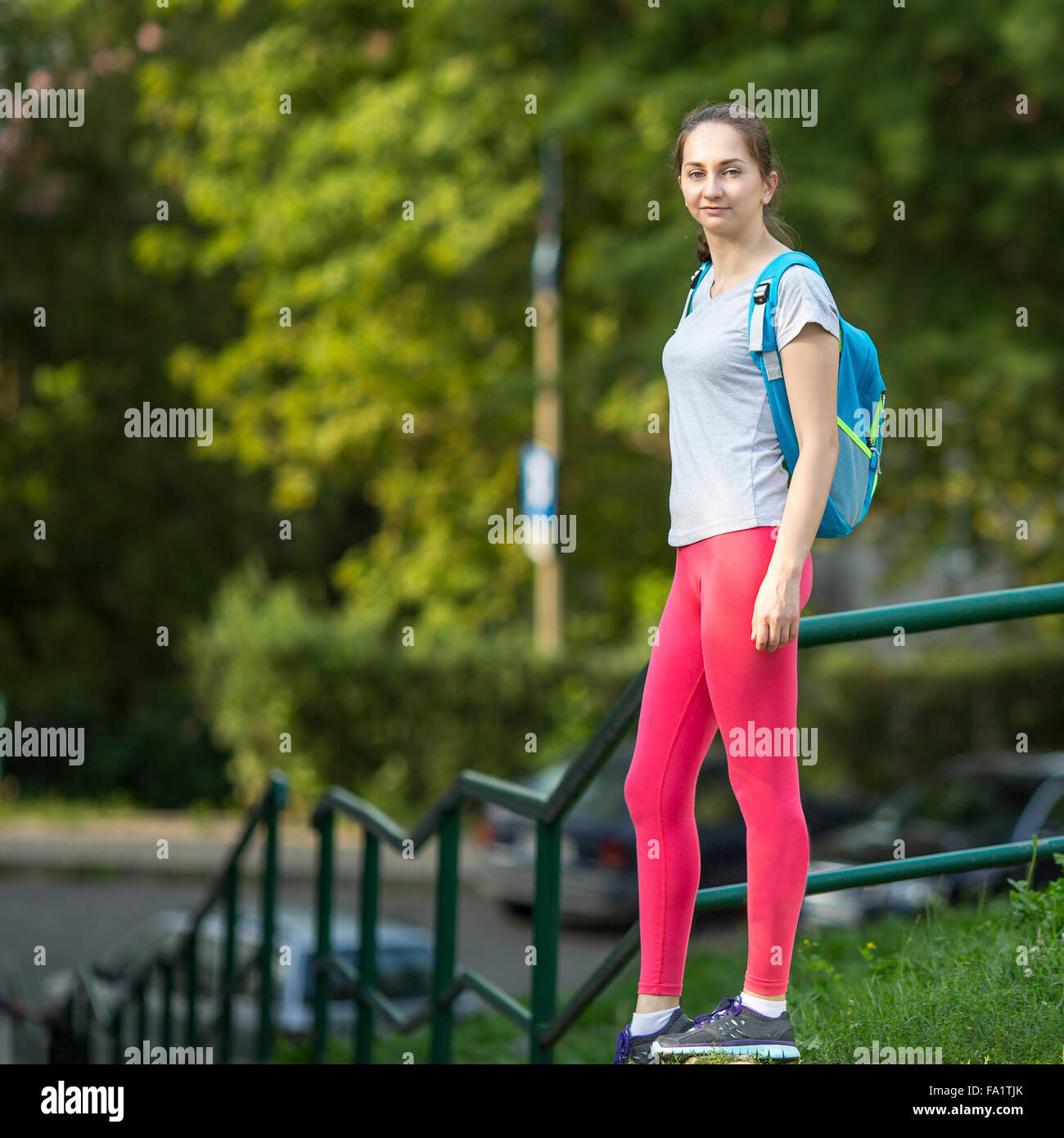 Young sporty girl outdoors before training. - Stock Image
