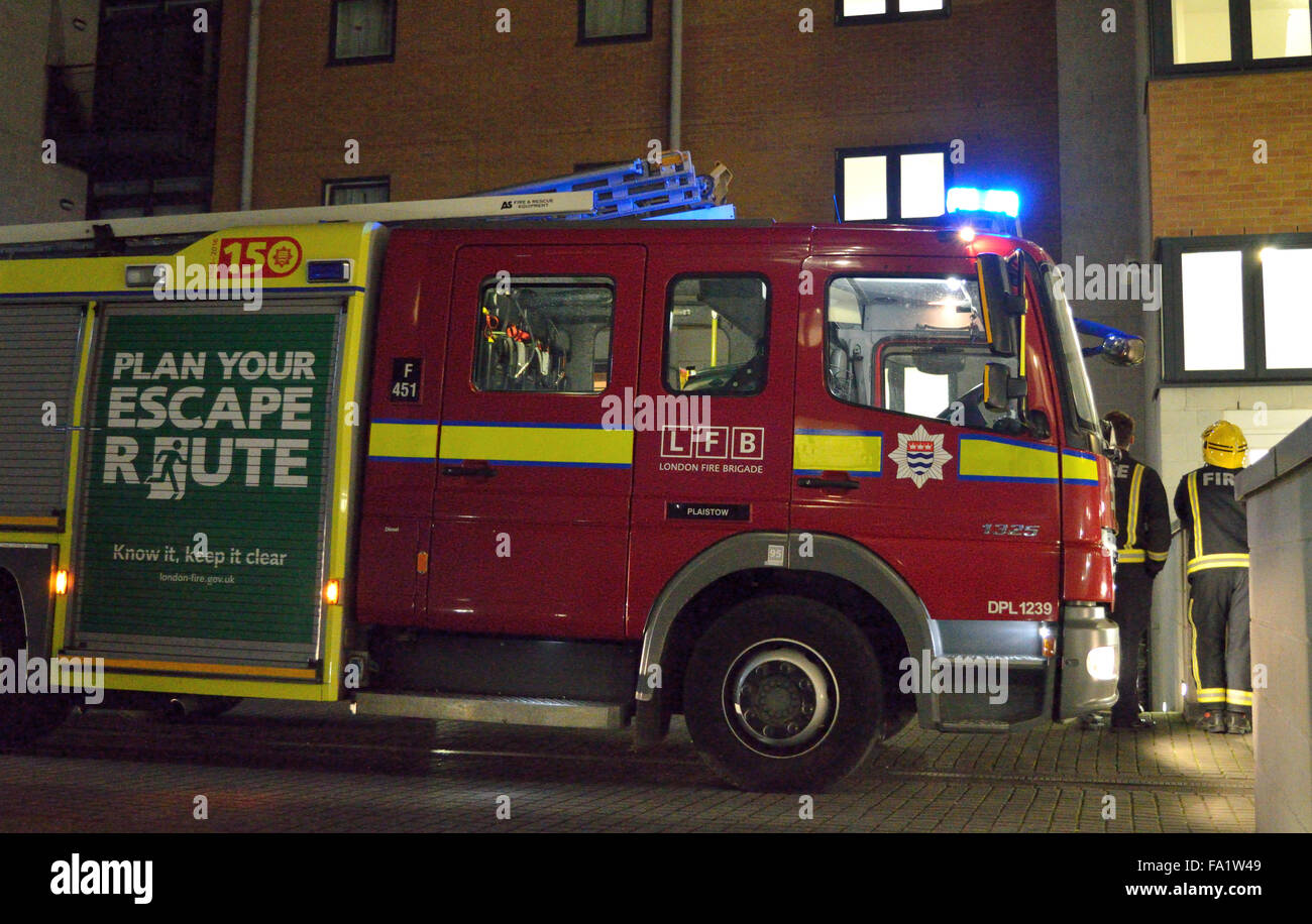 Fire appliances from London Fire Brigade attend a flat fire in North Woolwich, London - Stock Image